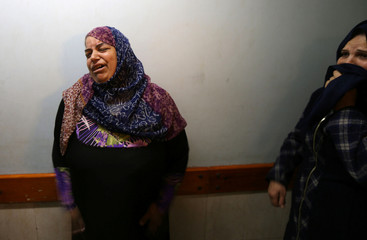 Relatives of a Palestinian who was wounded during clashes with Israeli troops react in a hospital in the southern Gaza Strip