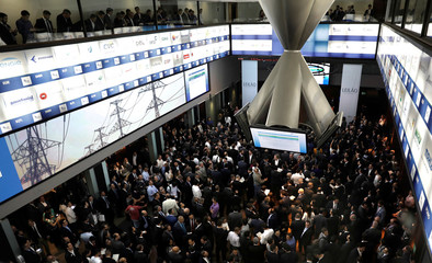 Investors attend a government-sponsored auction to award licenses for investors to build and operate almost 5,000 kilometers of power transmission lines, at B3 in Sao Paulo