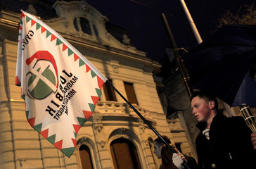 A supporter of Hungary's main opposition Jobbik party attends a torchlight demonstration in Budapest