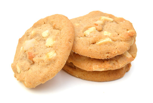 Small stack of macadamia nut and white chocolate cookies.