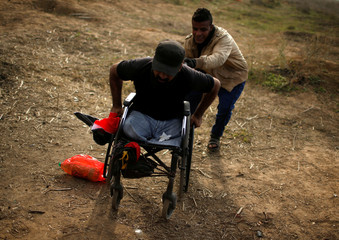 Wheelchair-bound Palestinian demonstrator Ibraheem Abu Thuraya, who according to medics was killed later on Friday during clashes with Israeli troops, is pushed during a protest near the border with Israel in the east of Gaza City