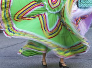swirling green Mexican dance costumes