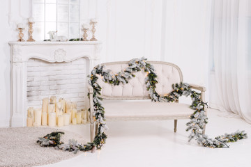 White classic interior with fireplace, sofa and christmas decorations.