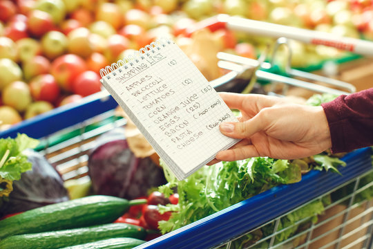 Person shopping at the grocery shop food concept