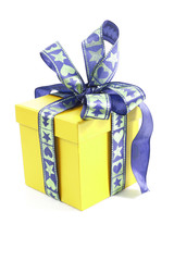 Yellow surprise gift box on isolated white studio background. Christmas anniversary or birthday gift present surprise. Gift box. Yellow blue.