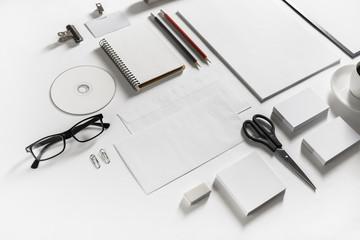 Photo of blank corporate identity. Stationery set on white paper background. Branding mockup.