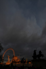 The London Eye is illuminated by a sunset in London