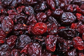 Cranberry raisins. Red whole dried raisins as background. Red cranberry mullberry raisins closeup texture.. Food photos.