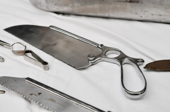 Stainless steel surgical saw dating from the early 20th century used for amputations.