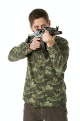 Man with a beard in military uniform with an automatic weapon on a white background
