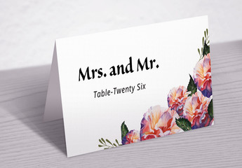 Wedding Table Place Card Layout with Floral Elements