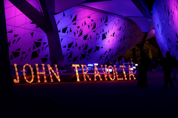 A lighted sign with the name of the actor John Travolta is seen at APEX Convention Center in Riyadh