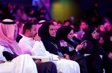 People attend the performance of actor John Travolta at APEX Convention Center in Riyadh