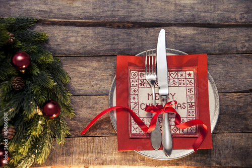 Christmas Menu Table Set A White Plate With Silver Cutlery Wrapped