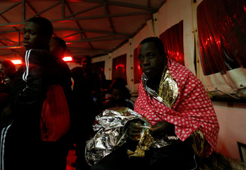 Migrants rest on MV Aquarius, a search and rescue ship run in partnership between SOS Mediterranee and Medecins Sans Frontieres, after being rescued in the central Mediterranean 69 nautical miles off the coast of Libya
