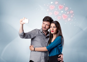 Couple in love taking selfie with red heart