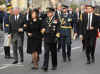 King Carl Gustaf of Sweden and his wife, Sweden's Queen Silvia, attend a funeral ceremony for late Romanian King Michael in Bucharest