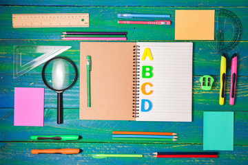 Top view of School and office supplies stationery on wood background,back to school concept.