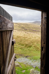 Hut near high pike Cumbria Way good for shelter in bad weather like this England