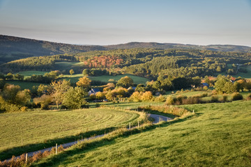 Warm golden sunrise colors over the Belgium Ardennes near the forest of Hampteau
