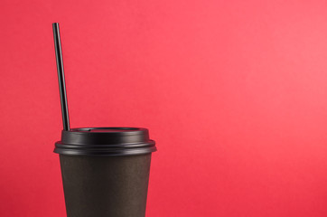 Closed Coffee Cup on red background.