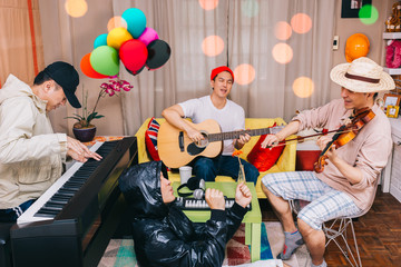 happy family, brotherhood and friends playing music in the party at home