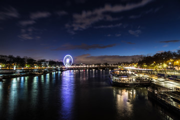 Beautiful Dusk over looking The Pont Alexandre III and Ferris Wheel from Pont des Invalides in Paris.