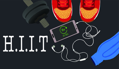Fitness, healthy and active lifestyles concept. Dumbbells, sport shoes, smart phone with earphone and water bottle on gym floor with word hiit (high intensity interval training)