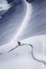 Freeride skier skiing through deep snow, Kuhtai in Austria