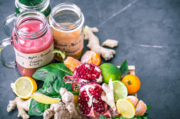 vitamin fresh fruit smoothies in glass jars with fruit