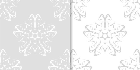 Light gray floral ornaments. Set of seamless patterns