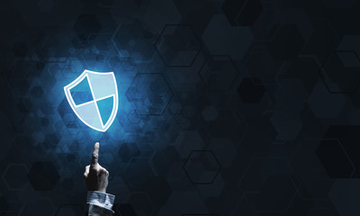 Blue shield icon as symbol of access protection on dark background