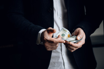 man counting USA Dollar bills