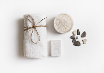Poster de jardin Spa Beauty and spa concept. Towel, sea salt, pumice and stones on white paper background. Flat lay.
