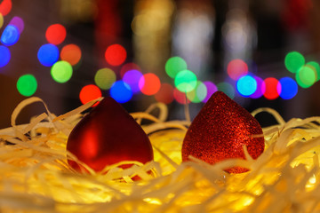 christmas decorations with  heart shape, under  blurred background.