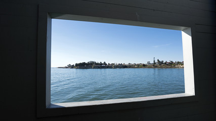 Pier window offers a frame for a view towards Santa Cruz waterfront.
