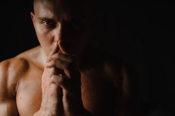 Close up portrait of muscular and tanned athletic guy