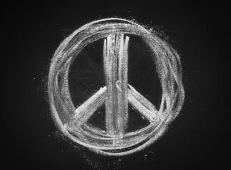 Peace symbol, sign on chalkboard, blackboard texture