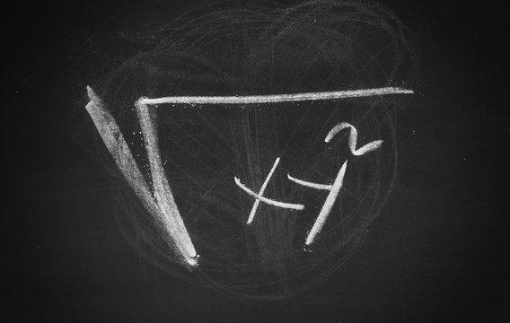 Mathematical formula, equation symbol, sign on chalkboard, blackboard texture