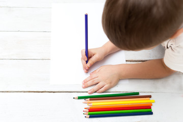 hands of a kid drawing with on paper flat lay - Kid Drawing Picture