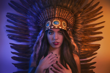 Headdress, beautiful girl with plume of american indian feathers