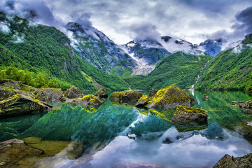 Amazing lake on a background of mountains and glacier. Norway. Beautiful landscape. Artistic picture. Beauty world. Wall mural
