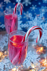 festive Christmas drinks with candycanes and snowflakes closeup