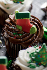 Christmas cupcakes with decorations and sprinkles closeup