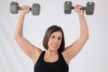 Lovely lady lifting weights