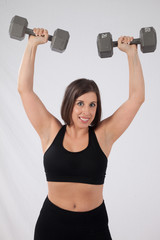 Pretty woman lifting weights