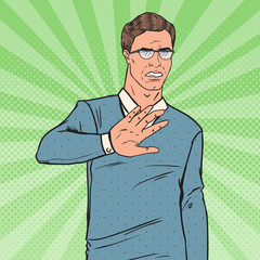 Pop Art Disgusted Man. Guy Showing Stop Hand Sign. Vector illustration