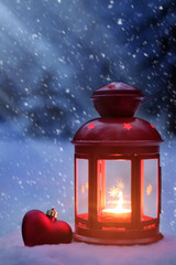 Moonlight on Christmas night. Christmas spirit in the woods. Light lamp with Christmas toys in the woods. Night magic for Christmas. Snow in New year night