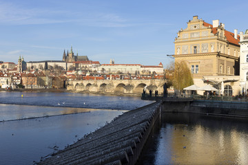 View on the winter Prague gothic Castle with the Charles Bridge in the sunny Day, Czech Republic