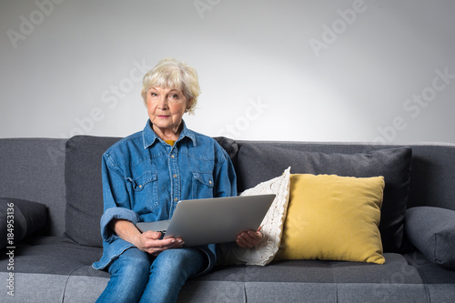 Half Length Portrait Of Old Woman Holding Notebook While Relaxing